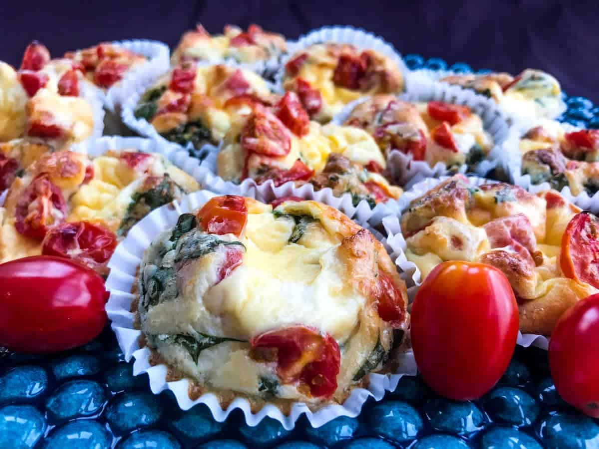 Healthy italian breakfast egg muffins on a blue plate on a purple surface